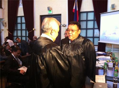 Photo from Rappler: Solicitor General Francis Jardeleza with Atty Harry Roque before the oral arguments on the Cybercrime Law at the Supreme Court